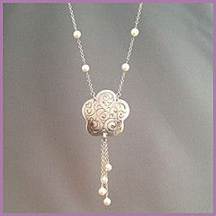 'Drops of Pearls' necklace: - pearls decorate this hand finished sterling silver floral pendant, decorated with fine scrollwork, and accented with freshwater pearls. Feminine, with a soft swing to it, you would love to be seen wearing this at a wedding, visiting friends, a day out showing off your new blue jeans. It just goes with everything. Suspended from a 24 inch s-silver chain. Buy for $122.50 at http://mosadijewelry.com/collections/mosadi-necklaces/products/drops-of-pearls
