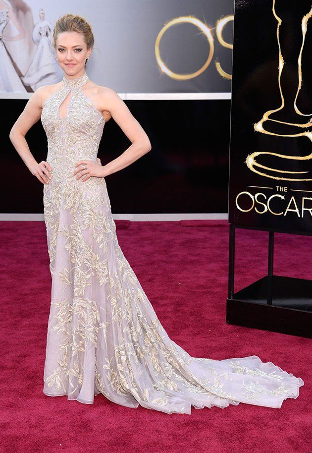 """Amanda Seyfried The """"Les Miserables"""" star had quite a big night ahead of her since she was slated to perform with her movie castmates, but the 27-year-old looked cool and collected on the carpet in her embellished Alexander McQueen gown with a keyhole neckline and long train. A soft updo completed the blond beauty's Oscars look."""