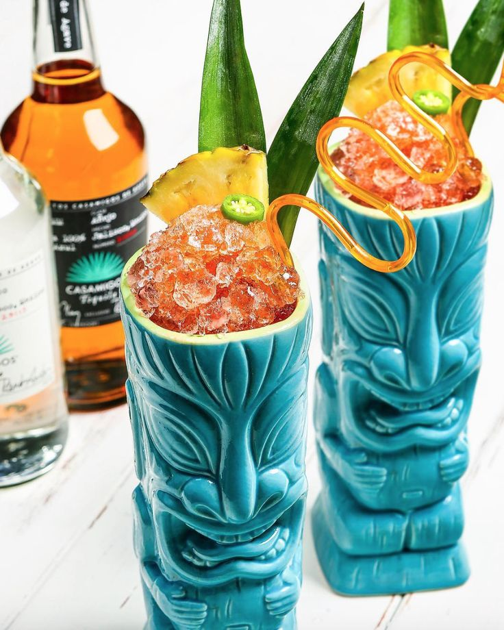 CASA TIKI  1 oz. Casamigos Blanco 1 oz. Casamigos Anejo 2 oz. Pineapple juice 1 oz. Fresh lime juice .5 oz. Ancho Reyes .5 oz. Agave nectar 2 Serrano slices Top off with angostura bitters  Combine all ingredients into tin shaker. Muddle herbs. Add ice. Shake vigorously for 8-10 seconds. Fine strain into #tiki glass. Add fresh ice and crushed ice dome at top of cocktail. Top off with angostura bitters. Garnish with 2 pineapple leaves, pineapple wedge and 1 serrano slice with tajin mixture…