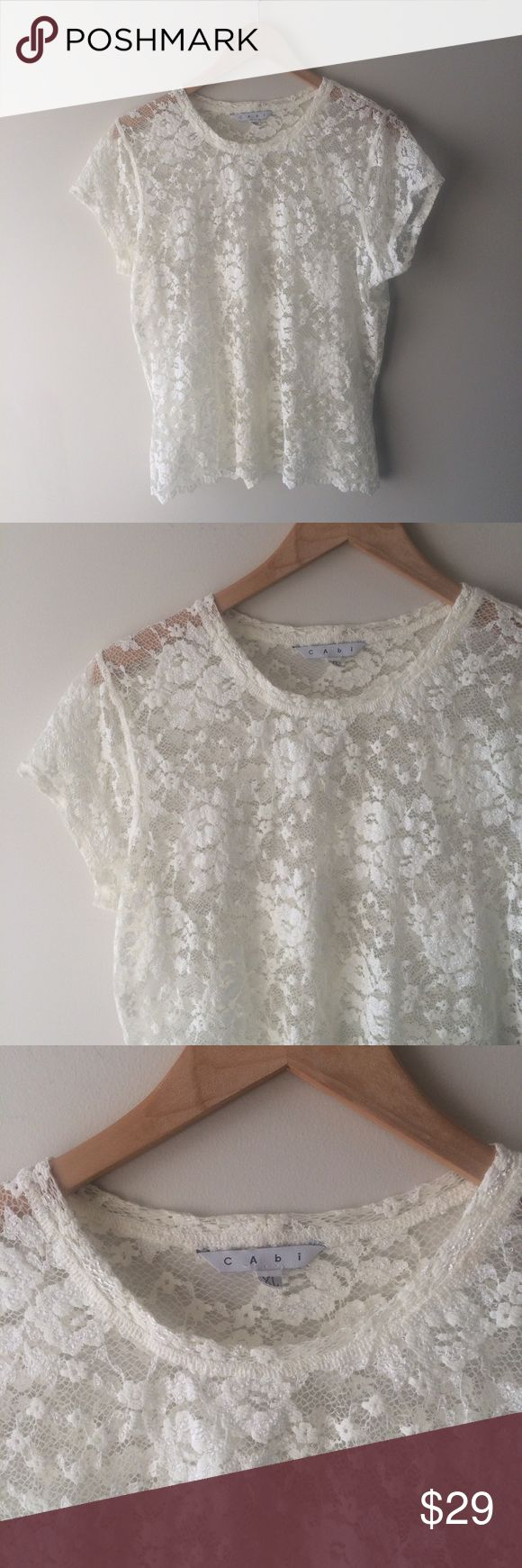 CAbi White Lace Crochet Short Sleeve Top Beautiful and elegant, this lace topper is absolutely lovely. White cream Lace, short sleeve, goes over any Tank. Size XL, excellent condition. CAbi Tops Tees - Short Sleeve