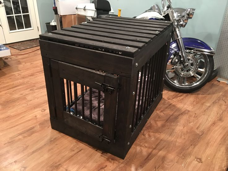 "DIY Indestructible crate - Pitbull proof.  I built this crate myself out of 2x4s (frame vertical, floor), 2x6s (top/bottom frame, and door) and 1x4s (roof). I used 32"" Baluster from HD on all side at about 4"" spacing, which are 1"" into the 2x6 top and bottom. All wood inside is wrapped with sheet metal which is curved around all inner wood to prevent chewing. It's bolted down to prevent being pulled off. Heavy duty hinges and gate latches. 3/8"" bolt on all sides for easy(relatively)…"