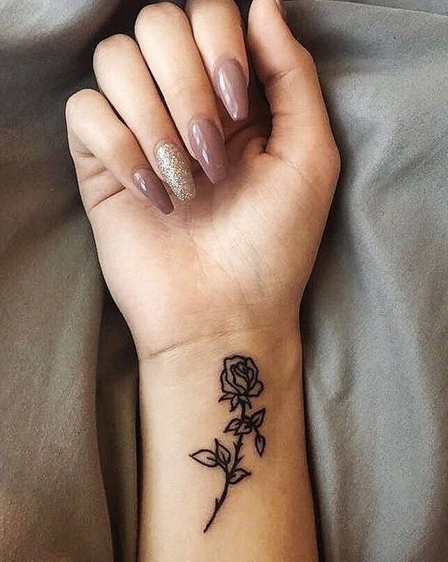 Amazing rose tattoo on wrist