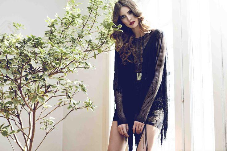 Black mash and lace mini dress with fringes: http://manuri.ro/product/4099/