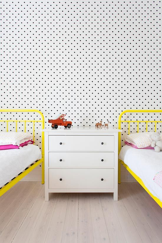 polka dot wall with bright yellow beds!