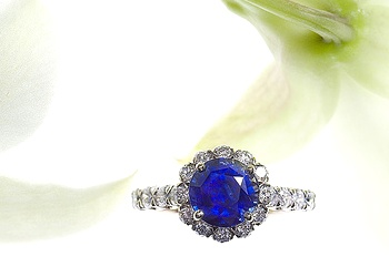 Christopher Designs engagement ring with a 2.65 ct round strong blue sapphire and 36 round brilliant diamonds at 0.86ct are set into 18K white gold.