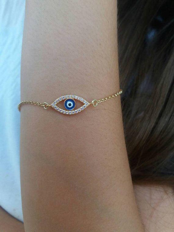 Check out this item in my Etsy shop https://www.etsy.com/listing/466623323/evil-eye-bracelet-gold-zircon-bracelet
