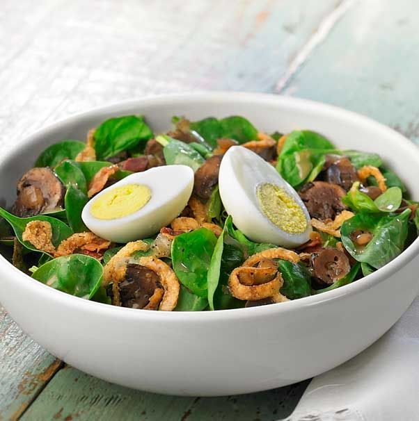 Panera Bread's Spinach Power Salad - Fresh baby spinach, a roasted mushroom and onion blend, hard-boiled eggs, applewood-smoked bacon and frizzled onions with our smoky Vidalia® onion vinaigrette.-