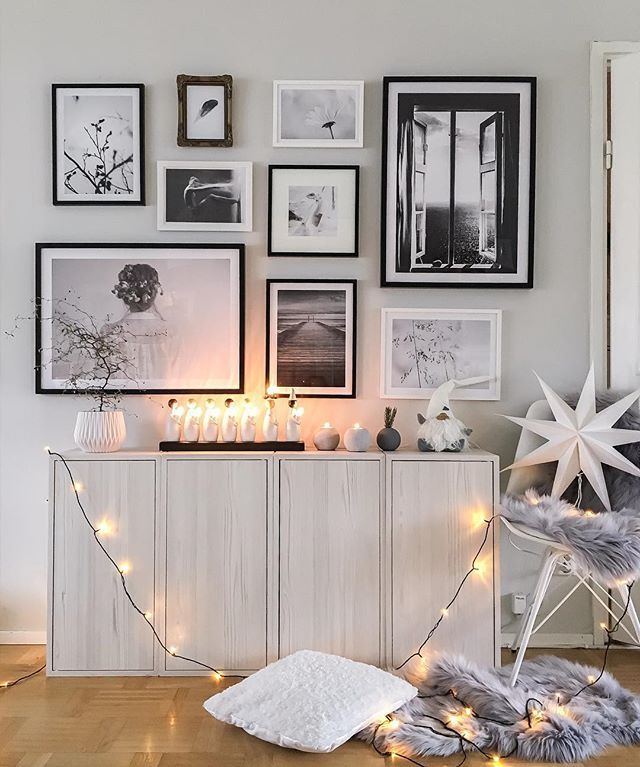 Lovely photo wall in white home with framed posters from Printler, the marketplace for photo art. Interior design by interiorbysarahstrath at instagram.