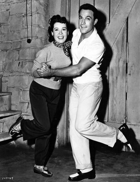 """Gloria DeHaven and Gene Kelly on the set of """"Summer Stock"""" in 1948."""