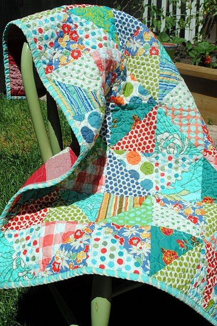 Cute and simple quilt- the variety of fabrics really makes this. It would also be fun in flannels- bright, but super warm. CC