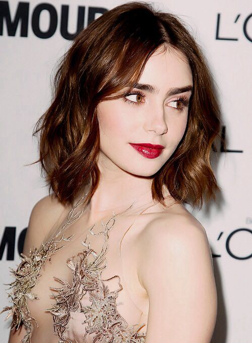 Lily Collins- is an English and American actress. She was born in England, and grew up in LA with her mother. She is the daughter of musician, Phil Collins. She graduated from the University of Southern California with a degree in Broadcast Journalism.