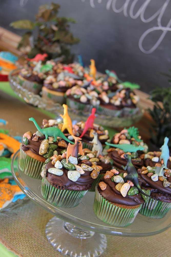Chocolate rock cupcakes at a dinosaur birthday party! See more party planning ideas at CatchMyParty.com!