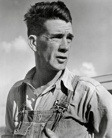 """""""Tom Joad"""" Silver gelatin print 1938 John Steinbeck's novel, The Grapes of Wrath, narrates the story of a family of migrant farmers as they travel from Oklahoma to California. Through main characters like Tom Joad, Steinbeck portrays the life of a Dust Bowl family struggling to survive. Horace Bristol's portrait of the migrant farmer that influenced Steinbeck's character shows a rough, wrinkled face, which was a result of long exposure to the sun and possibly a poor diet."""