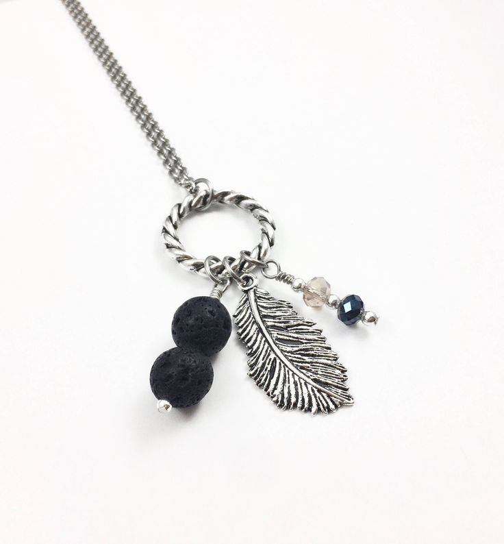 Excited to share the latest addition to my #etsy shop: Silver Feather Lava Stone Diffuser Necklace, Essential Oil Diffusing Necklace, Aromatherapy Necklace, Oil Gift for Her, Lava Bead Necklace