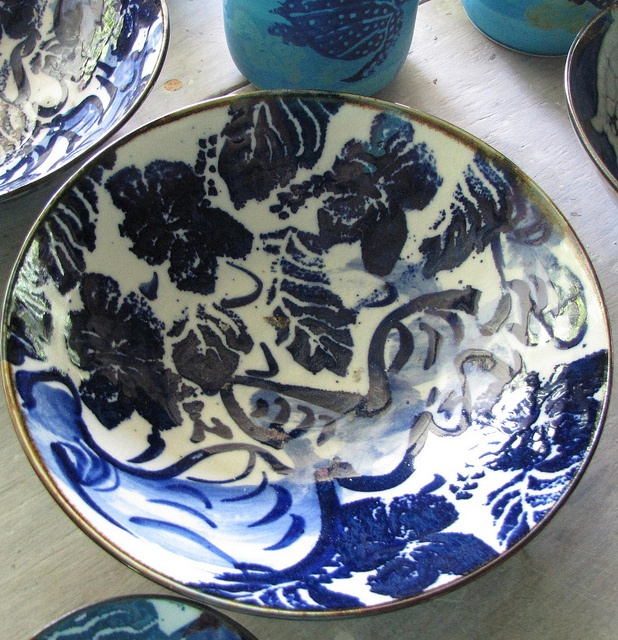 Salad bowl with cobalt hibiscus design.