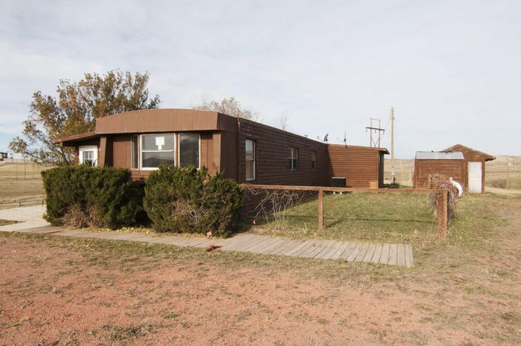 "Gillette, WY home for sale! 38 Freedom Rd - 3 bd, 2 ba, 1212 sqft, 2.5 acres. HUD home sold ""as is."" Call Team Properties Group for your showing 307.685.8177"