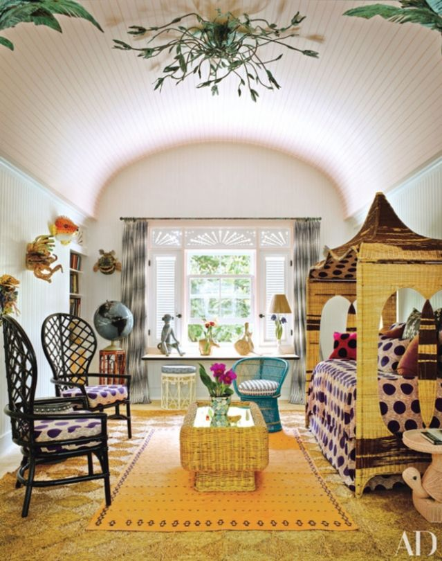 Luxe hotel tour: Playa Grande Beach Club, Dominican Republic: A ceiling light designed by Kemble Interiors oversees the children's playroom; the furniture is upholstered in Dutch-wax prints from AKN Fabrics, and the orange rug is from Nomadic Trading Co.