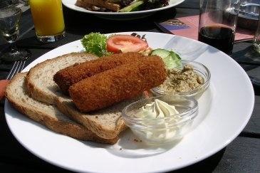 Broodje Kroket - usually chicken, the deep fried kroket is served hot & eaten after it's spread on a piece of bread.