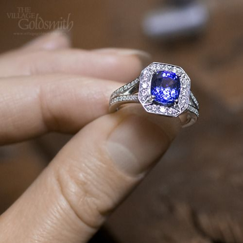 Sapphire and Diamond ring with a 2.76ct Ceylon cushion cut sapphire surrounded by clusters of diamonds. Have you seen the jewellers in action in our workshop yet?