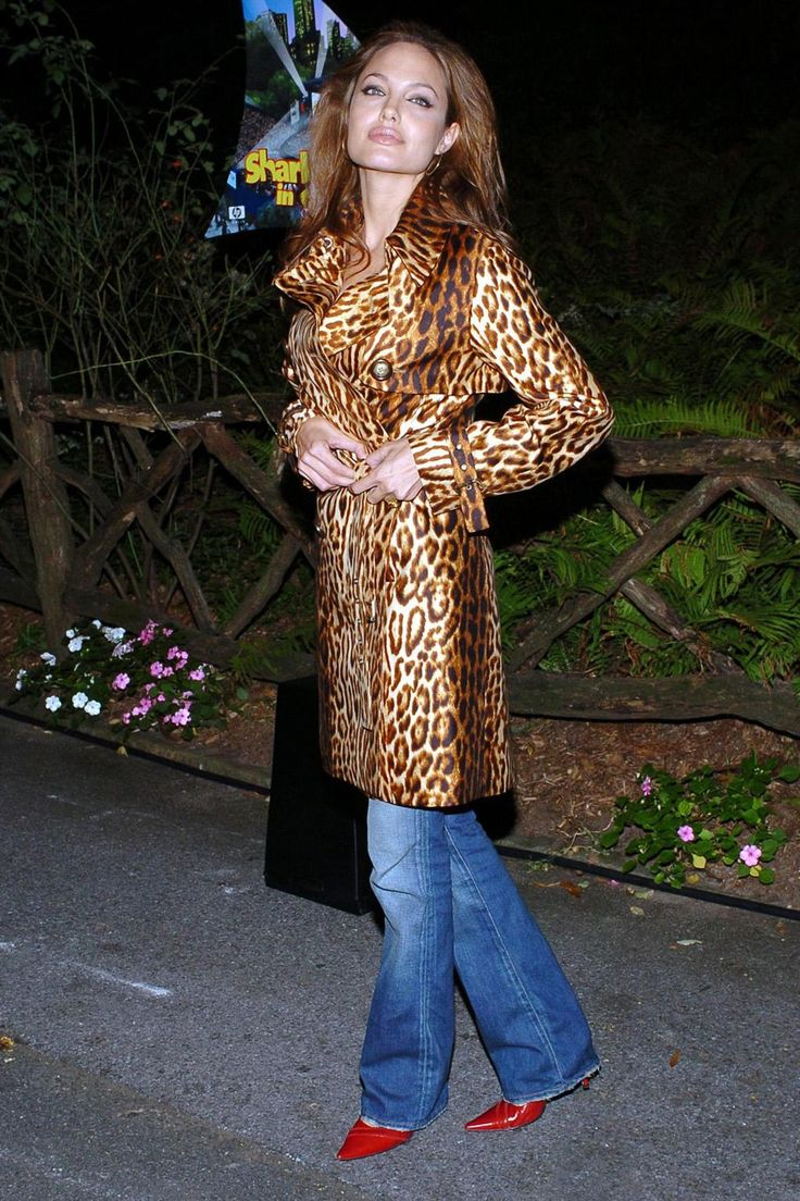 She wrapped up in a leopard print trench coat for the [i]Shark Tale[/i] in New York.