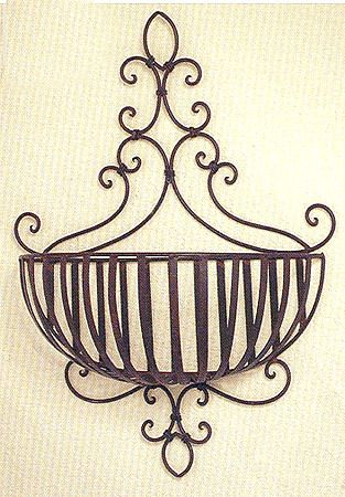 wrought iron planter hung on the kitchen wall to hold fruit or other items  For the Bathroon ~ towels perhaps!