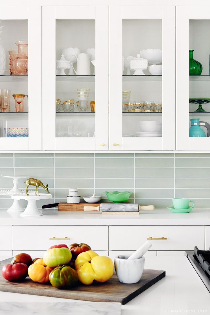 White kitchen with glass cupboards