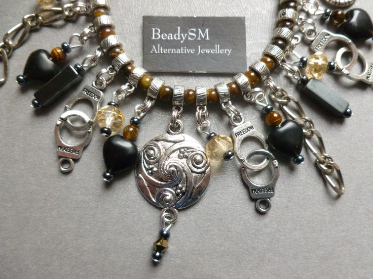 BeadySM BeadySM  - registered trademark jewellery.  Citrine; Onyx; Tigerseye and Tibetan Silver fetish charm bracelet.