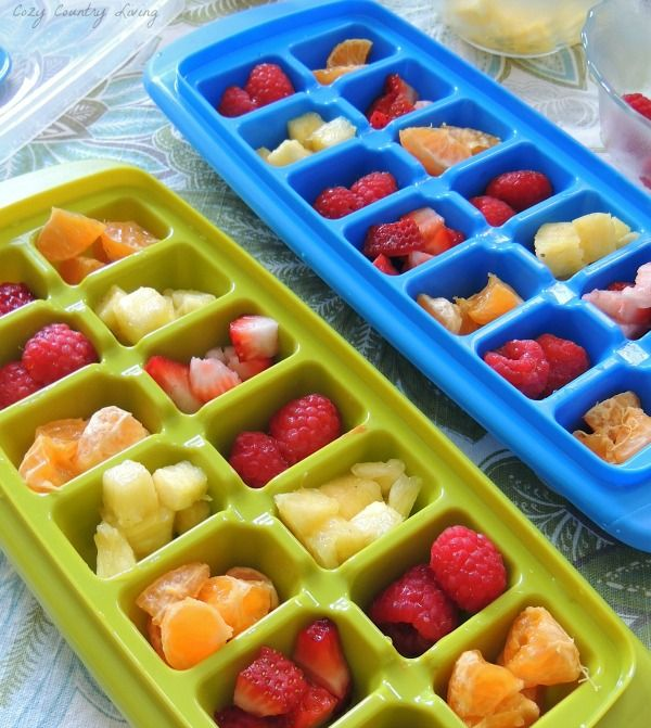 Fun & Fruity Ice Cubes Add Fruit To Ice Cube Trays, Fill with Water & Freeze! CozyCountryLiving.com #summer #drinks
