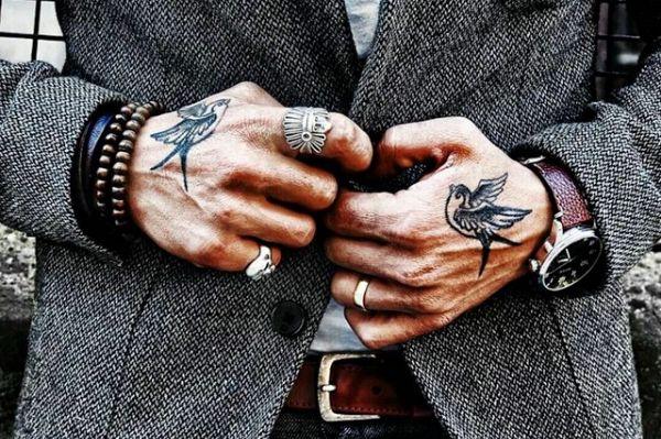 swallows / hand tattoos