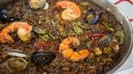Learn how to make authentic Spanish seafood paella and sangria