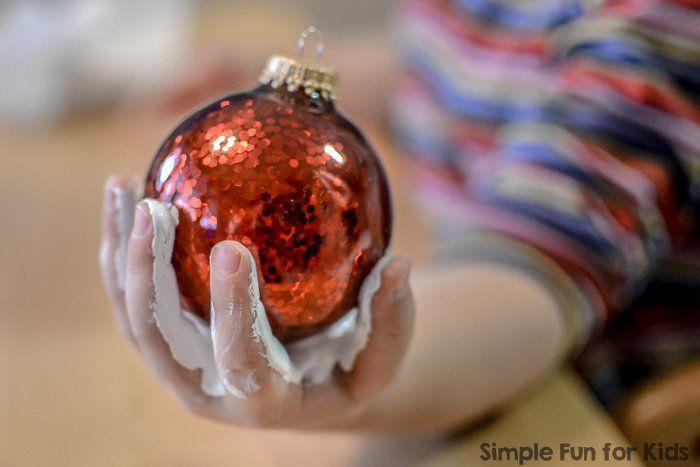 Handprint Snowmen Christmas Ornaments: A super cute quick Christmas craft for kids!