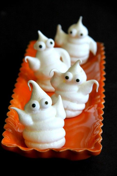 Haunted Halloween Ghost Cookies -- a simple almond-scented meringue piped in the shape of ghosts solves your Halloween party dessert needs. Make them spooky or horror -- your choice. #SundaySupper @dixiecrystals