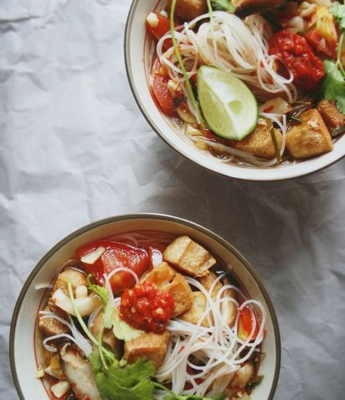 Tom Yum; a fragrant,spicy Thai sweet and sour soup with fried tofu and rice noodles.