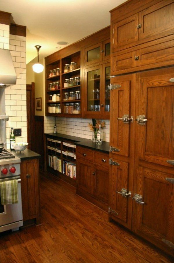 Wood Floors. Medium wood cabinets. Black counters. Perhaps I should go with the subway tile.