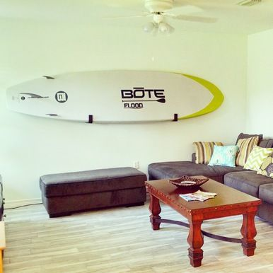 The StoreYourBoard Naked SUP Rack. Turn your paddleboard into art and organize your house at the same time!