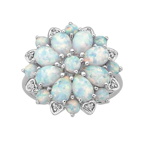 Fred Meyer Jewelers   Created Opal and Diamond Fashion Ring. I want this ring! Its so awesome!