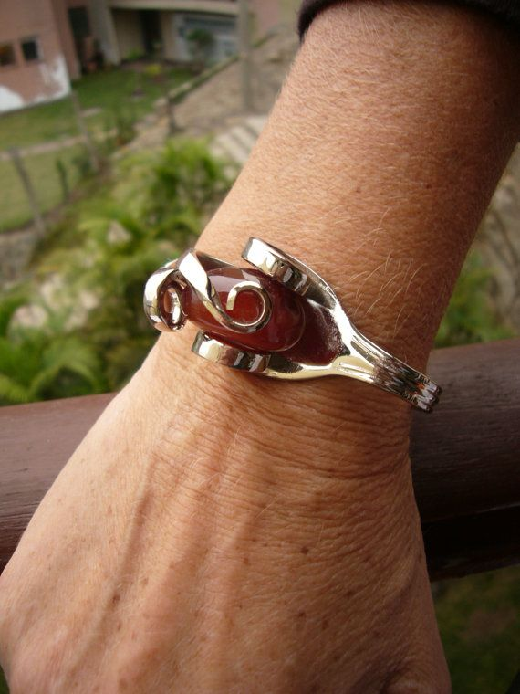 fork bracelet inset with large red gemstone http://www.squidoo.com/fork-jewelry