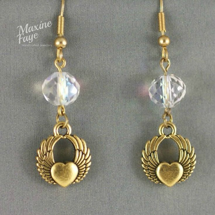 Distinctive Tierra Cast®️️️, antiqued gold-finished pewter, double-sided winged heart charms are embellished with radiant clear AB finished crystal rondelles to make these chic earrings.  The total length is approx  5.25cm and findings are gold-plated. https://www.maxinefaye.com.au/product-category/earrings/