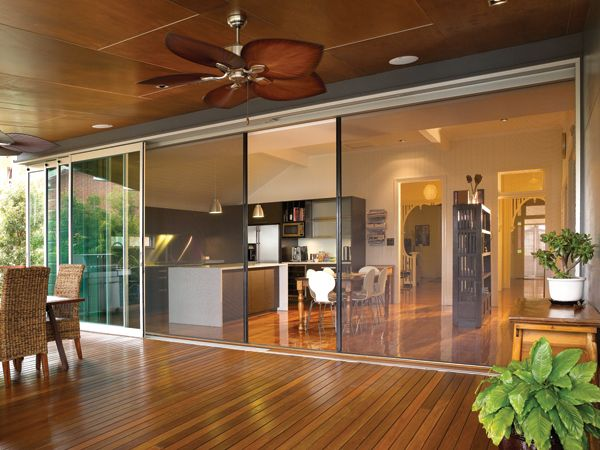 L:  Really like this:  open kitchen, doors that open fully, retractable fly screens, wide veranda, ceiling fans on the veranda, lights in the ceiling of the veranda, lots of wood.  What's not to like???