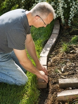 Love the idea of brick or stone edging instead of concrete edging!