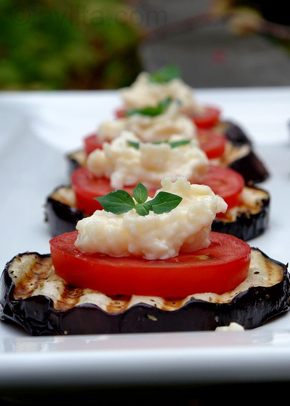 Eggplant Appetizer by laylita: Grilled eggplant slices topped with tomato slices, garlicky parmesan sauce and fresh herbs. #Eggplant #Appetizer #laylita