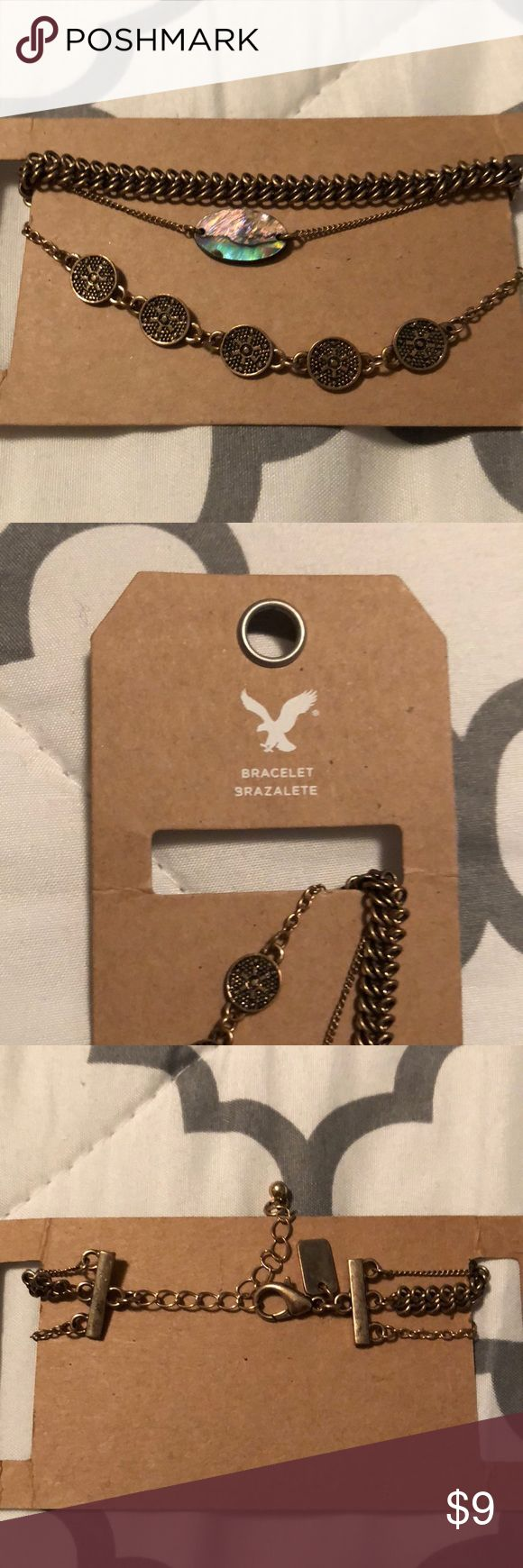 NWT- American Eagle 3 strand Bracelet Dark gold 3 strand bracelet by AMERICAN EAGLE!  Never even taken off the cardboard holder.  Pet free, smoke free Ships in 24 hours! American Eagle Outfitters Jewelry Bracelets