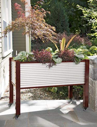 galvanized elevated raised bed on casters is ideal for gardening on a patio or deck metal