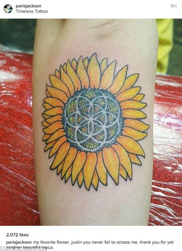 New tat: Paris Jackson proudly showed off a new sunflower inking on Sunday
