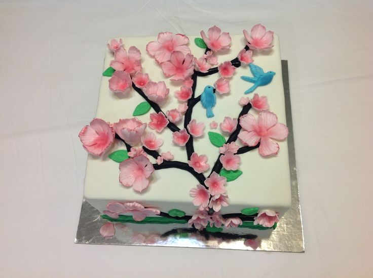 Exquisite double decker, cherry blossoms mud cake with blue birds. Serves 40.