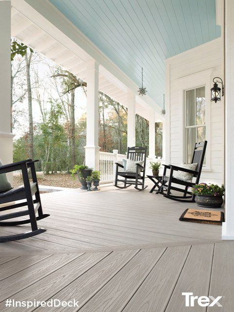 Full of Southern comfort and charm, this porch features durable Trex Transcend Gravel Path porch boards, Trex Transcend railing with colonial spindles in white and Trex Outdoor Furniture rocking chairs. Visit Trex.com for more inspirational deck designs. #InspiredDeck #sweepstakes