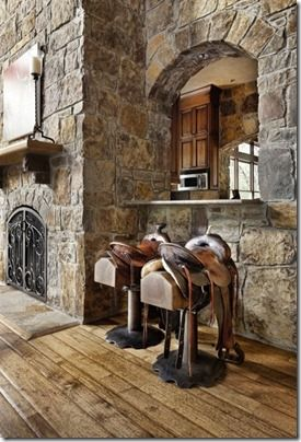 Rustic western saddle bar stools. Timeless staple of western home decorating. They never go out of style. | Stylish Western Home Decorating