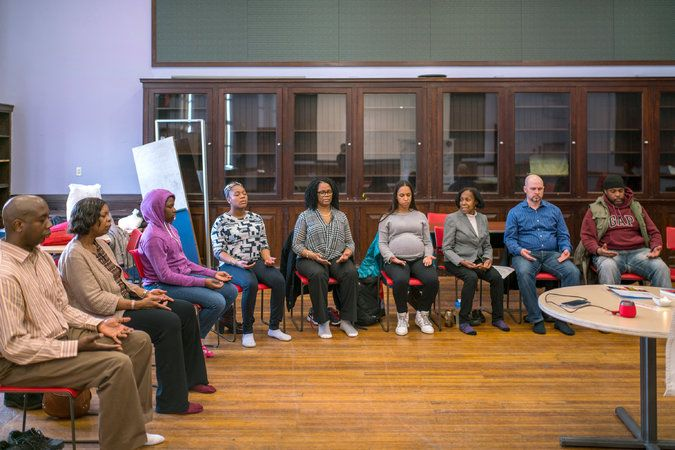 I feel... a serene calm in the community room as patrons partake in a meditation class.   (NYC Public Library Mediation Class)