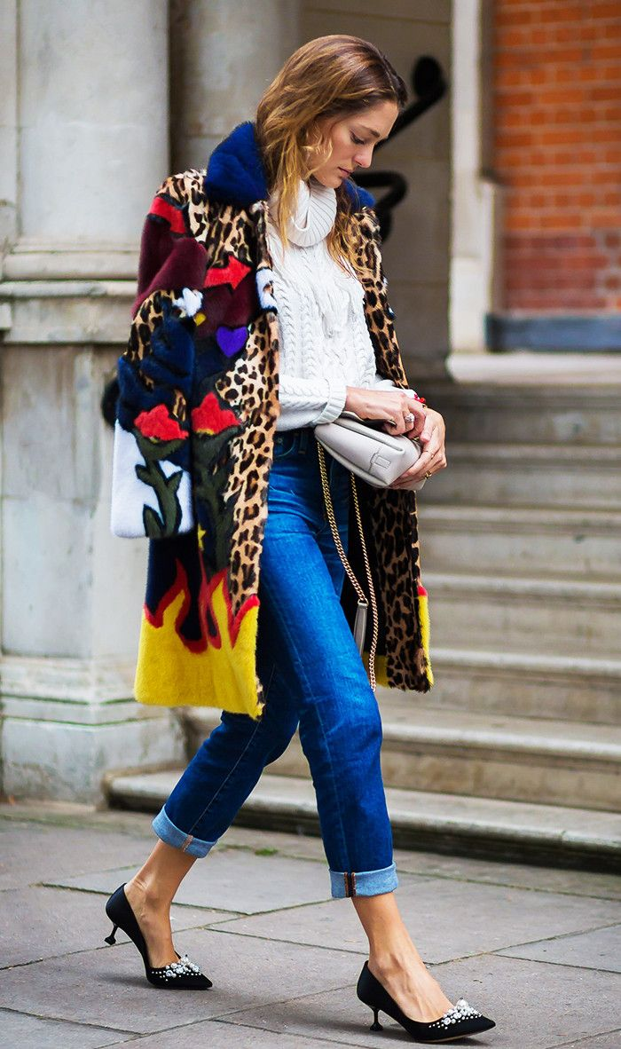 Cuffed jeans with a mixed print coat and kitten heels.