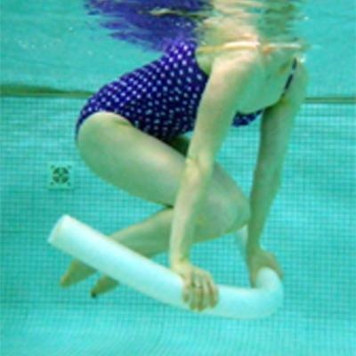 Burn Calories in the Pool (No Laps Required!)NOODLE PLANK WITH KNEE TUCK